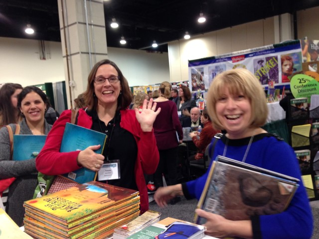 Tricia Stohr-Hunt (in red) and Linda Kulp Trout at the Lerner signing